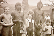 With Maasai friends on our farm at Athi River, ca. 1953. My sister Rhodia (left), myself (center), and our brother Oscar (right).